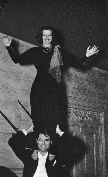 Katharine Hepburn and Cary Grant larking about during the filming of Holiday, 1938.