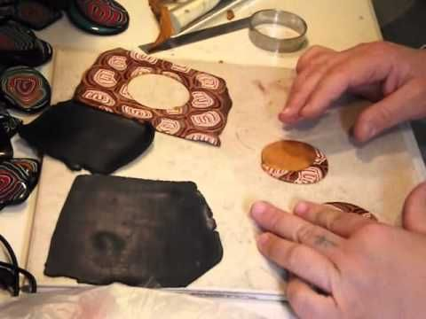 How to make jewelry from polymer clay slices. Nice tutorial showing how to make a patterned sheet with cane slices and then piece together that sheet with a plain sheet of polymer clay to make a pendant or earings.
