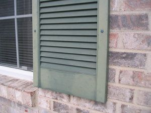 These faded green shutters can be made to look just like new with soap, water and some urethane resin paint.