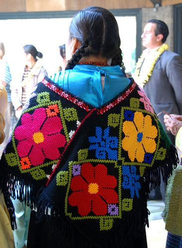 Flores Mexicanas - Colorful flowers bloom in the hands of Mexican artists.