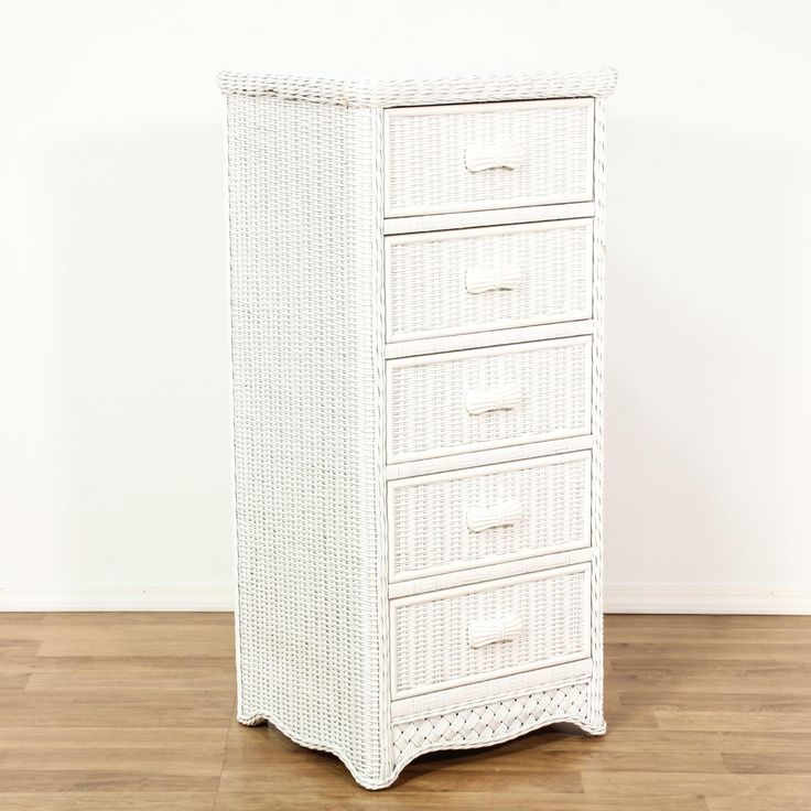 This cottage chic dresser is featured in a woven wicker with a fresh white paint finish. This tall dresser has 5 drawers, narrow sides and latticework accents. Perfect storage piece for a skinny space! #cottagechic #dressers #talldresser #sandiegovintage #vintagefurniture