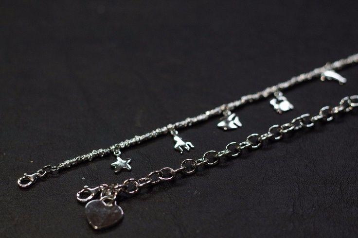 Bracciale con charms animali e bracciale con cuore entrambi in argento. Adatti per un bellissimo regalo a una persona cara.