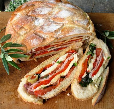 Pan Bagnat ~ A French Picnic Sandwich. Make with ciabatta bread next time for individual sandwiches. The longer it sits, the wetter it in. Put roasted pepper in the middle instead of the bottom.
