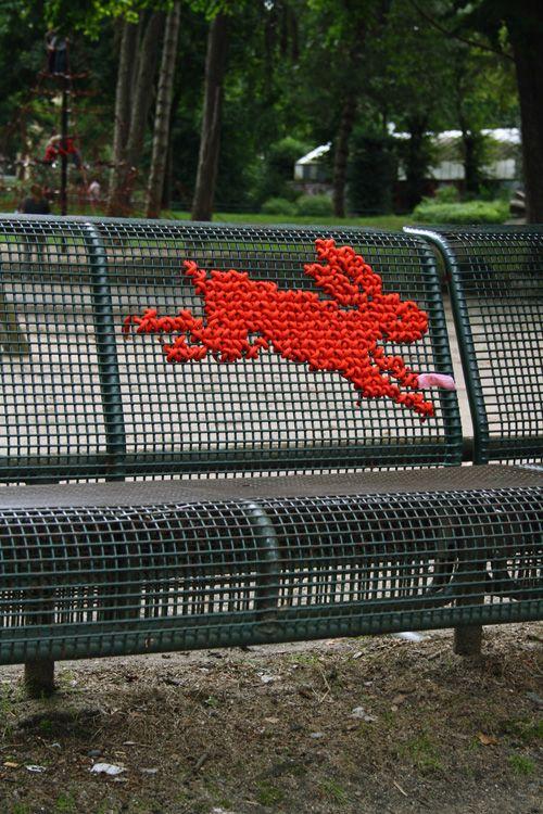 Koln - red rabbit cross stitch yarn bomb