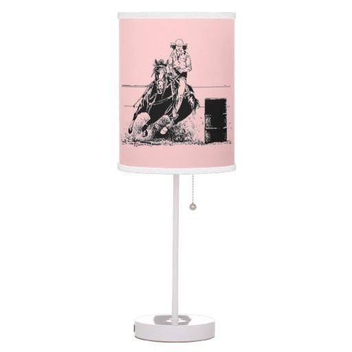 A great pink lampshade for the cowgirl who enjoys barrel racing featuring a horse & rider whipping around a barrel in black!  For more clocks visit http://www.zazzle.com/clocks?rf=238308729910790362
