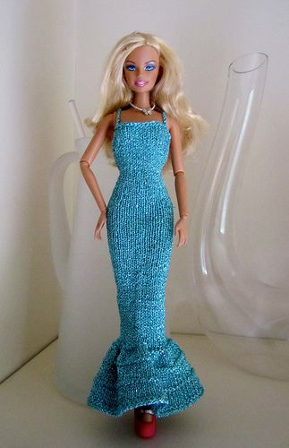 A long evening gown for Barbie with backless bodice and straps that criss cross in the back.
