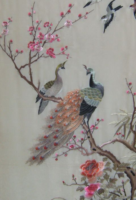 Chinese silk embroidery on silk panel of a peacock perched on a flowering plum branch with peonies and other birds, circa 1870.
