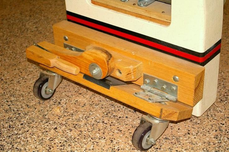 """Built using standard hardware and non-locking polyurethane casters. It lifts the Jet 1642 lathe 1/2"""" off it's feet. I did a similar set for my maple workbench."""