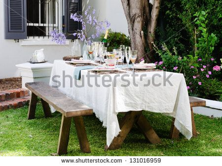 Table setting for an outdoor garden party with neutral nude color scheme - stock photo