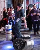 One server rolled around on a Segway-like contraption that held a keg of beer. He rolled up to guests and...