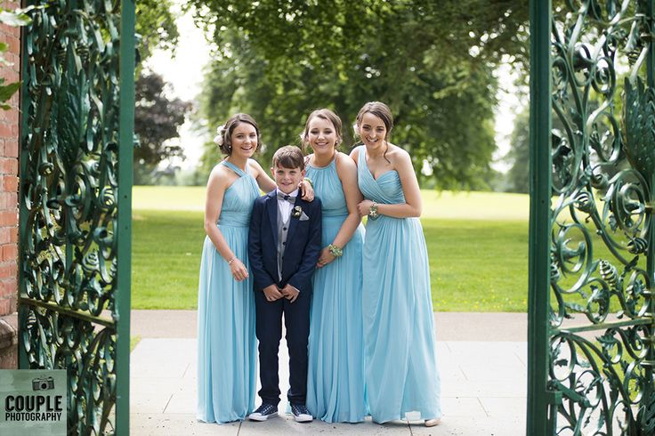Family photo at the ornate Tankardstown gates. Weddings at Tankardstown House by Couple  Photography.