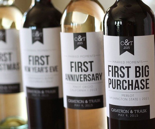 """Turn your favorite wines into celebratory drinks with help from these marriage milestone wine labels. These custom labels can be fitted over any bottle to help you commemorate special events like your """"first big purchase"""" or """"first fight""""."""