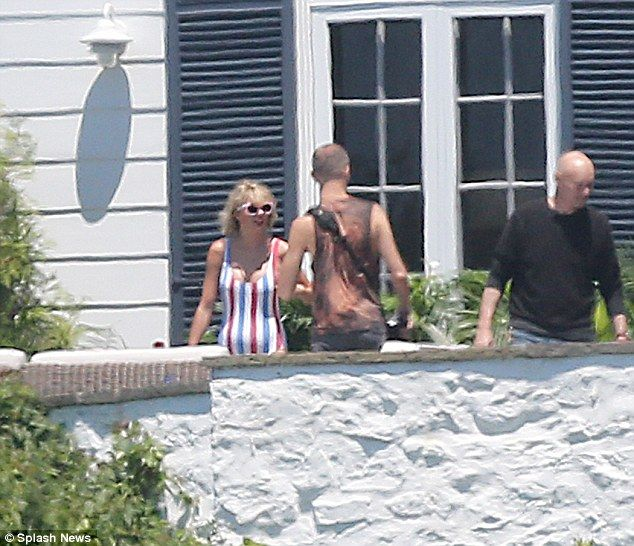 Miss America: Taylor Swift, 26, was certainly feeling patriotic as she donned a red, white and blue striped swimsuit for her star-studded bash Independence Day bash