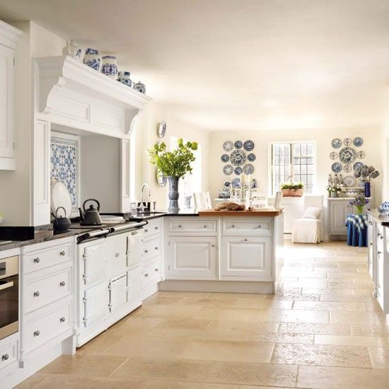Walnut country kitchen | Country kitchen ideas - 10 of the best | housetohome.co.uk Fabulous collection of blue and white plates as a foil to the whiteness of the units