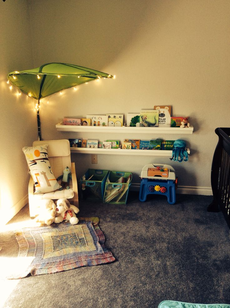 Reading nook. Rain gutter book shelf, ikea leaf canopy decorated with string lights.