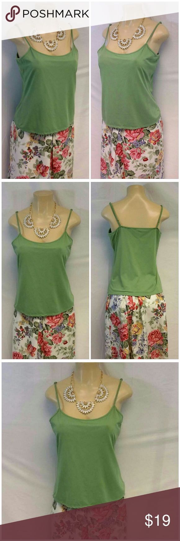 "HILLARY & HANSEN Green Cami size XL HILLARY & HANSON Green Cami, size XL See Measurements,  adjustable straps, shelf bra, very stretchy, machine washable, approximate measurements depend on stretch and adjustable straps: 23"" length shoulder to hem, 18"" minimum bust laying flat but stretches. A staple in every wardrobe. Hillard & Hanson Tops Camisoles"