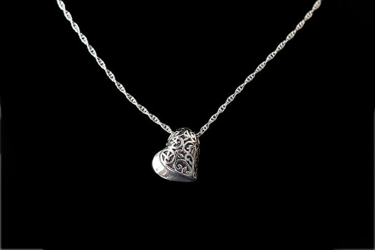 """A keepsake urn pendant which holds a small portion of cremated remains (ashes) is one way to honor a lost loved one on a very personal level. Both of these necklaces are made out of stainless steel and come with an 18"""" stainless steel chain. Some of the advantages of stainless steel jewelry is that it is scratch resistant; it does not tarnish and therefore will retain its polish longer than other metals; and it's generally considered hypoallergenic for most people.Two designs are available…"""