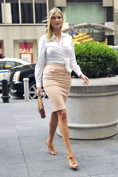 Ivanka Trump pairs her classy white wrap top with a nude pencil skirt and tan accessories. Perfect for an office look. #wrap