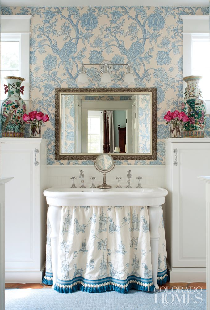 interesting bath storage solutions. double pedestal sink w skirt and isn't that trim fabulous! the trim detail makes this a designer piece not just DIY. Like the matching fabric and duck egg blue wallpaper.