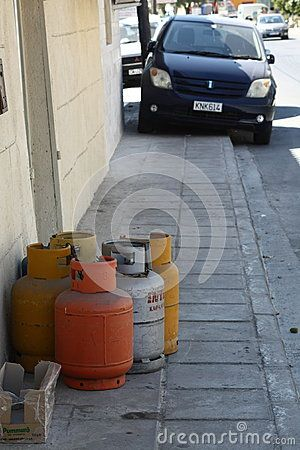 The domestic gas cylinders on the sidewalk at a small store in Larnaca. Cyprus