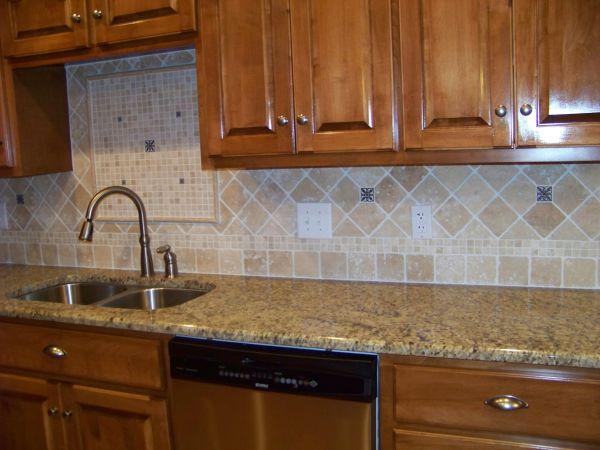 medium brown stained cabinets with new venetian gold granite