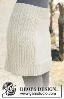 "Belle - Knitted DROPS skirt with cable pattern in ""Karisma"". Size: S - XXXL. - Free pattern by DROPS Design"