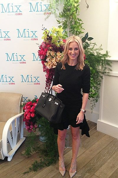 """""""On site at the Mix Apparel Launch with new face Ashley Hart, wearing Jac+Jack cashmere knit, Balenciaga skirt, Valentino heels, Hermes Birkin and Rolex Daytona in rose gold."""""""