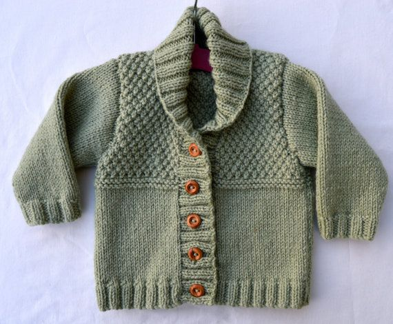 This spiffing little Baby Boy Sweater Cardigan is handknitted in Alpaca Wool in Pistachio Green, with a lovely shawl collar and a textured yolk. Made to Order, simply request the size you need.  Please note that different computers or Ipads interpret colours slightly differently so bear this in mind. For your information, I describe this as a Light Pistachio Green.  *** If you wish to have this sweater in a different size and/or colour I would be pleased to knit it for you. Just go to th...