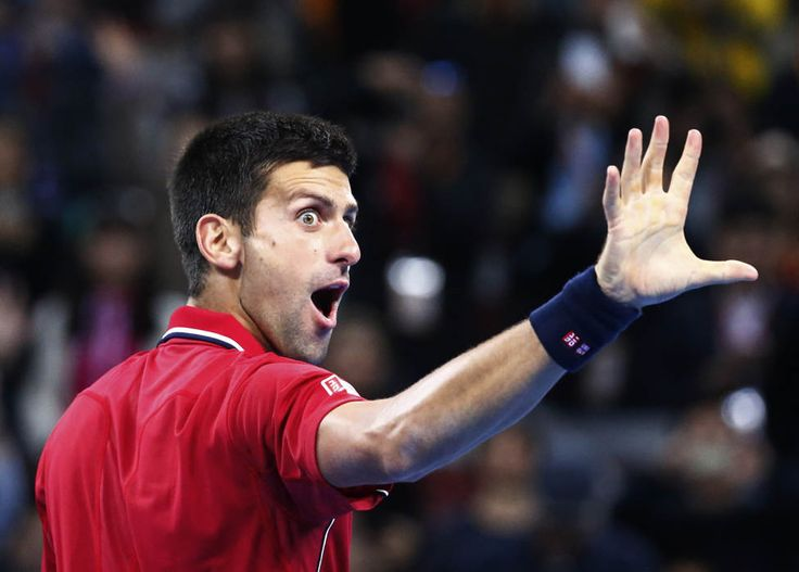 Novak Djokovic of Serbia celebrates after winning against Tomas Berdych of the Czech Republic during the men's singles final match at the China Open tennis tournament in Beijing October 5, 2014. (REUTERS/Petar Kujundzic)
