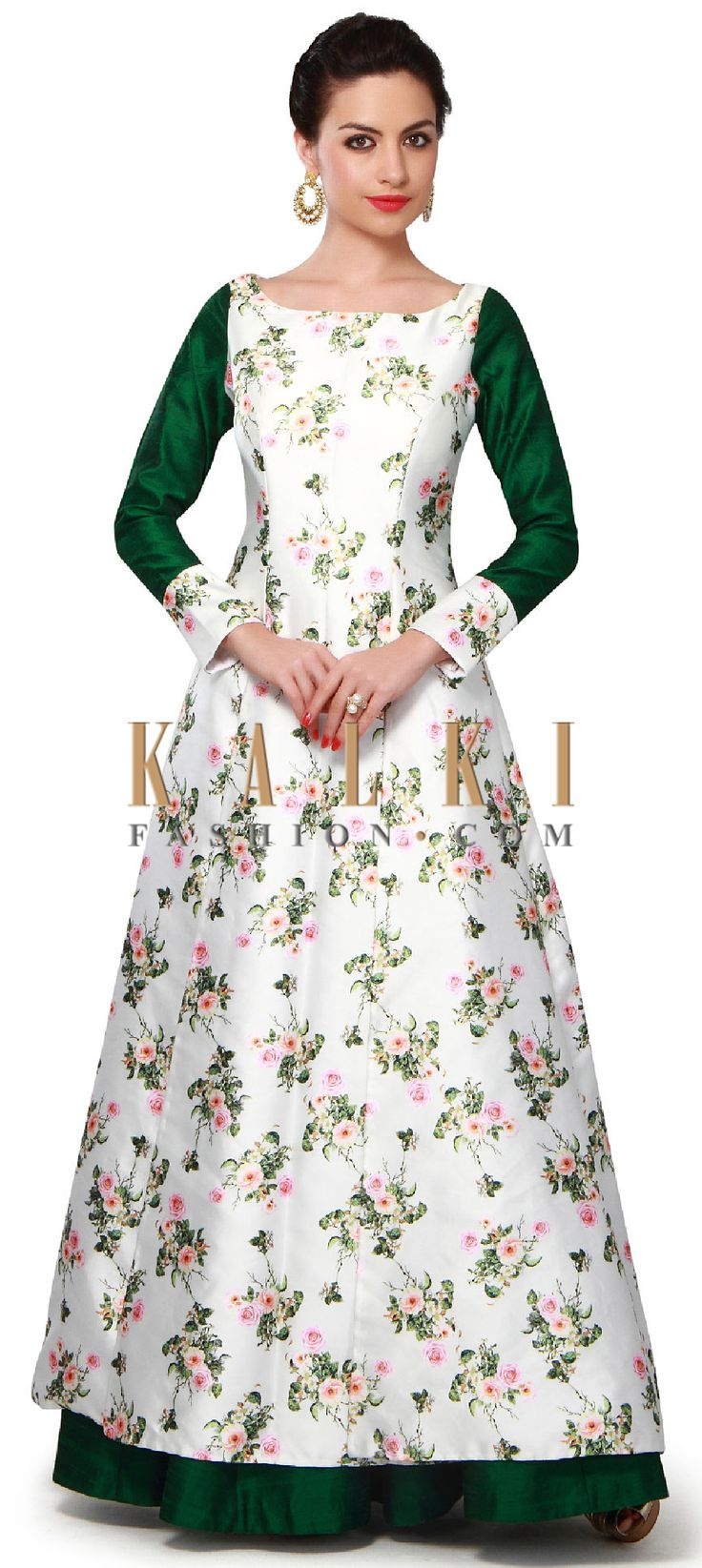 Buy Online from the link below. We ship worldwide (Free Shipping over US$100). Product SKU - 318363. Product Price - $319.00. Product link - http://www.kalkifashion.com/white-and-green-silk-dress-adorn-in-floral-print-only-on-kalki.html