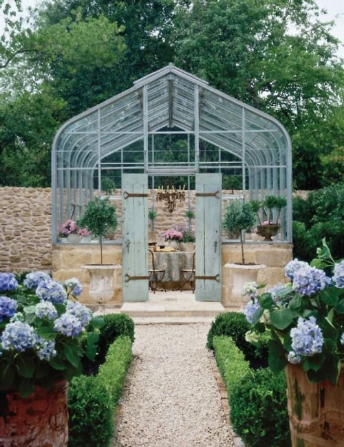 Would love to have a greenhouse ... with a chandelier nonetheless!      via Habitually Chic®