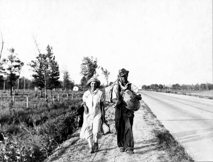 """May 1936, Crittenden County, Arkansas. Cotton workers on the road, carrying all they possess in the world. """"Damned if we'll work for what they pay folks hereabouts."""" Carl Mydans LC-USZ62-128671 www.loc.gov #American #History #Arkansas #DustBowl"""