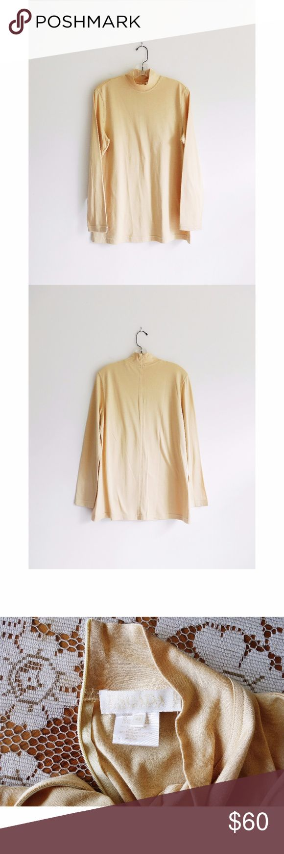 """Vtg Escada Beige Mock Neck Long Sleeve Shirt sz 12 Vintage Escada Margaretha Ley Beige Zip Up Mock Neck Long Sleeve Shirt size DE 42 US 12, excellent vintage condition--only imperfection is a very thin run or fabric defect on right shoulder--see pic 4, made in Italy, long sleeves, high mock neck, hidden quarter zip up back, jersey knit fabric in a nude/beige, 50% silk, 50% cotton, 16"""" across shoulders, 21"""" pit to pit, 29"""" shoulder to hem, 24.5"""" sleeve Escada Tops Tees - Long Sleeve"""