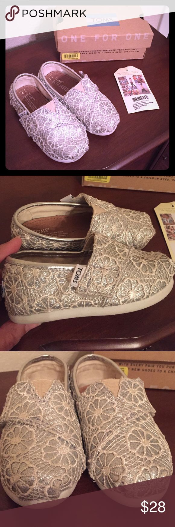 Adorable silver crochet TINY TOMS! Toddler Tiny Toms, perfect for your girly girl tot  In a neutral silver and creme lace overlay, these Toms are perfect for the holidays! Size 7T. Very gently used in EUC!! Comes with original box, Toms sticker, and tag. From a smoke and pet free home. Thanks for looking!  TOMS Shoes Dress Shoes