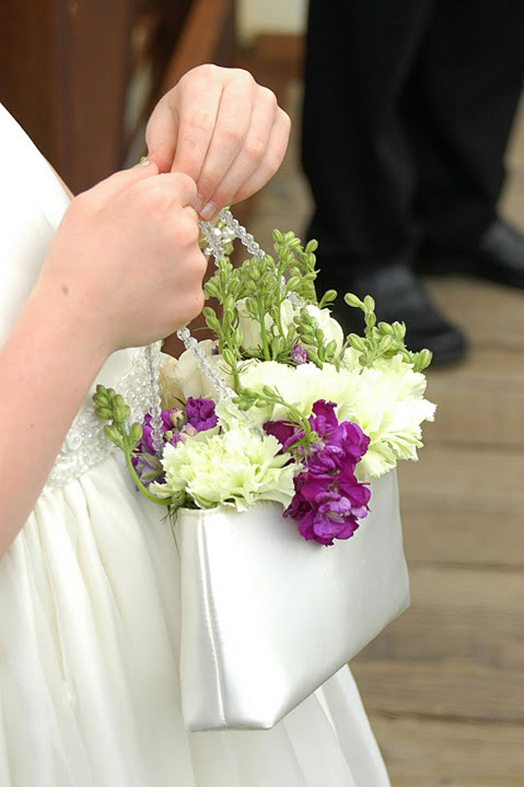 A cute flower girl idea! Flowers by Carol #Minnesota #weddings #weddingfloraldesign