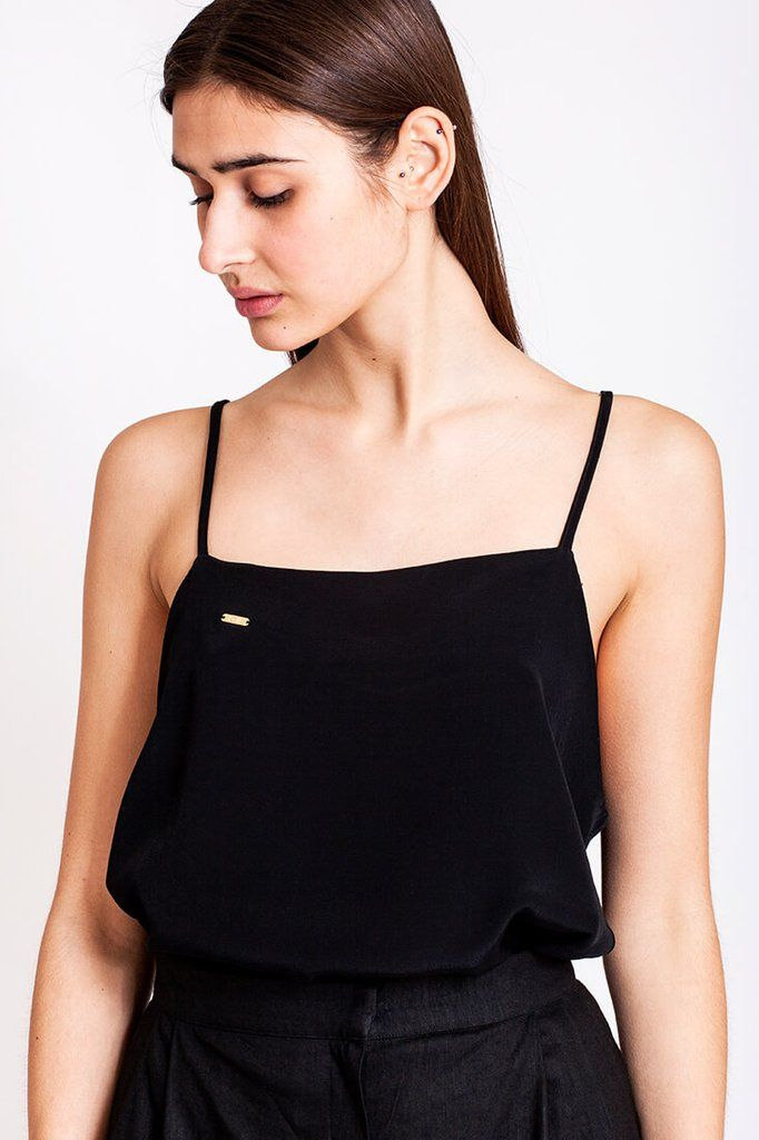 Black top by Dott. We can always use a basic top that is not just being basic and boring. The black viscose top from the Otherwise collection fits perfect to the black, wide, high-waisted pants from the same collection. Combine it with the pants for a chic look, or maybe a flowy summer skirt for a cute day-time look. There are no limits to how you can combine this beautiful top.   €60.00 REPIN TO YOUR OWN INSPIRATION BOARD