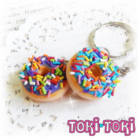 ♥ This listing is for a set of two (2) donut keychains. This yummy creation is completely designed and handmade by me. In this set you will recieve one donut with turquoise frosting, and one donut with purple frosting, both with rainbow sprinkles! ♥ Every piece of my work is completely handmade with love and attention to details. You will never find two items that will ever be exact, as I do not use molds or stencils, so each piece is completely unique and special!  ♥ Please note that…