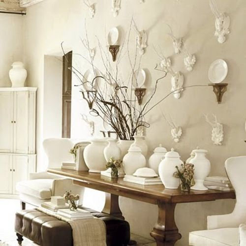 white collection displayed on dark wood