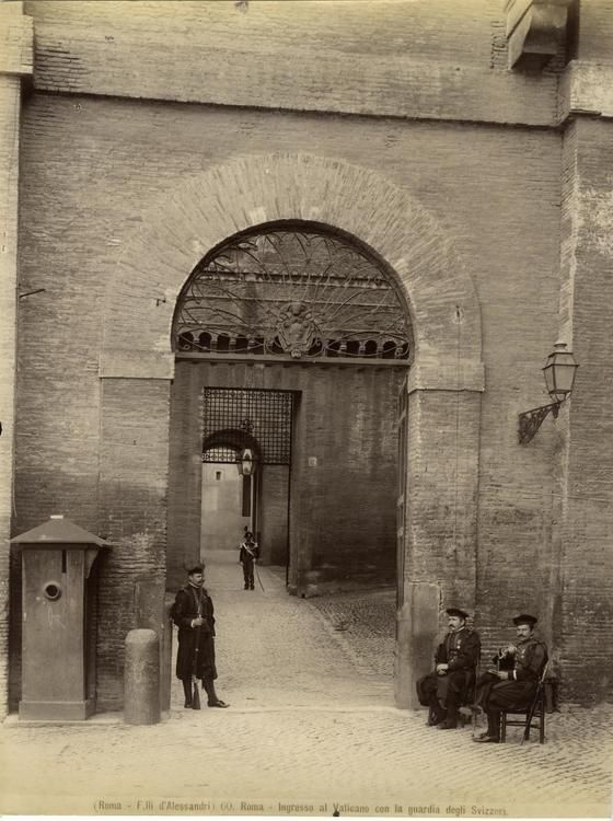 Swiss guards guarding the entry to the Vatican. In the background an Italian Carabiniere. Rome, late XIX century