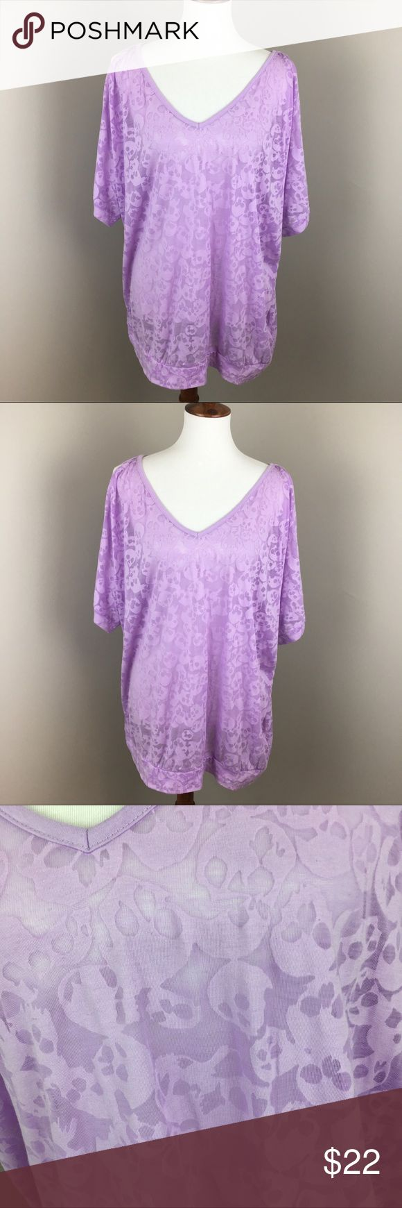 "Torrid Sheer Skull Top Size 3 Purple Women's Torrid Sheer Top with sculls. Size 3 (plus size). Color purple. Measurements- Bust 64"" and Length 29"". Has split sleeves. Top is in great condition. torrid Tops Tees - Short Sleeve"