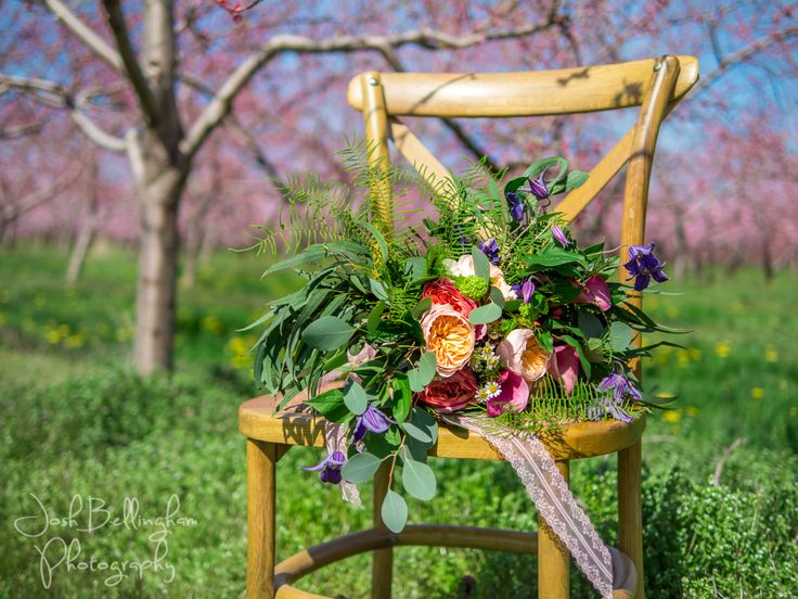 Beautiful bouquet created by the talented ladies at @pambocb Country Basket Flower Boutique in Niagara Falls Canada. Bouquet in a blossoming orchard.  @constellationev @WarehouseNOTL @orchardcroft  #JoshBellinghamPhotography
