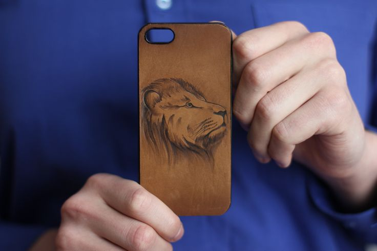 "iPhone case ""The Lion"". The material of product is the natural leather. There is burned image of the lion on the front part. We will can make specially case for your cellphone with your image. 18.69$ (isn't including shipping) #leathercase #tablet #iphone #handmade #russianhandmade #russian #russian_handmade #naturalleather #leather #cover #lion #case"