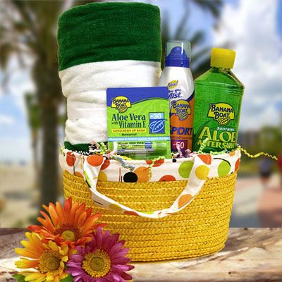 Sun Goddess  Summer Gift Basket    Soak up the sun with this phenomenal summertime fun gift basket. Fit for a Goddess this beach collection includes a festive print beach towel, Banana Boat sunscreen, lip balm and aloe vera gel. All the essentials they'll need to get the beach party goin!