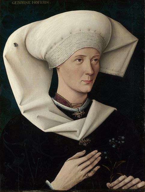 """Portrait of a Woman of the Hofer Family"", c. 1470, by an unknown artist. ""The sitter's family is identified by the inscription (born a Hofer), although her precise identity is unknown. She holds a forget-me-not, presumably for remembrance. On her headdress is a fly, either a symbol of mortality or a reminder of the artist's skills of illusion. The artist worked in Southern Germany; the portrait probably dates from about 1470."""