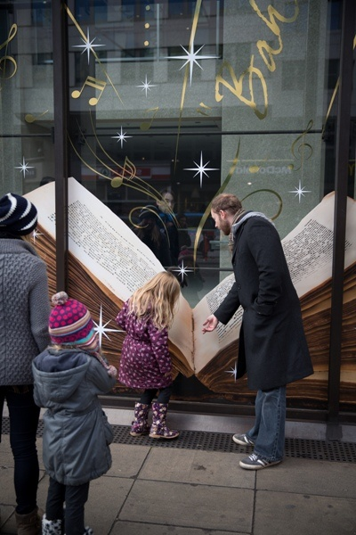 Onlookers enjoying the Coutts Christmas windows while install takes place.  Realised by JUSTSO Ltd. Photography by Goodguys