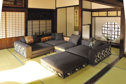 Japanese living room: style of couch, floor mats, and katana stand