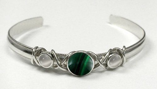Sterling Silver Hand Made Cuff with Genuine Malachite Accented with White Moonstone The Silver Dragon- Bracelets. $58.00. This Bracelet was Designed by The Silver Dragon, a Jewelry Shop in New England. Thank you for Supporting American Business.. Designed And Hand- Crafted in Sterling Silver. This Bracelet Fits a Standard Woman's Wrist. The Silver Dragon uses Sterling Silver that has been Reclaimed... Helping Save Mother Earth's Resources.. This Unique Bracelet is Created only ...