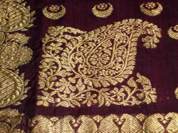 Aubergine-violet gara-style Banarasi Sari c 1900 using the boteh (paisley) motif. Note the embroidery quality difference between this (Indian) work from Banaras and the gara. Image credit: Woven Souls