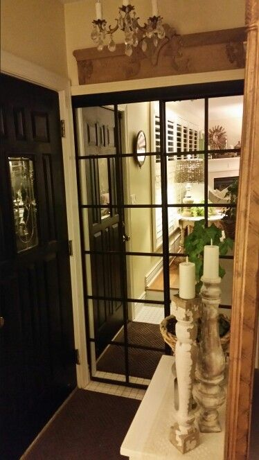 Dated mirrored closet doors transformed to look like industrial warehouse windows.
