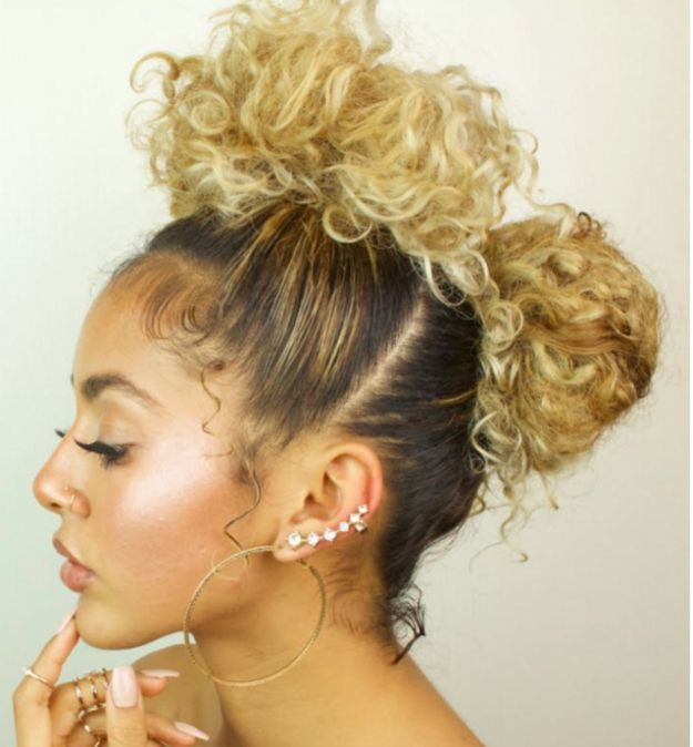Cute double buns | 17 Really Cute Hairstyles For People With Naturally Curly Hair